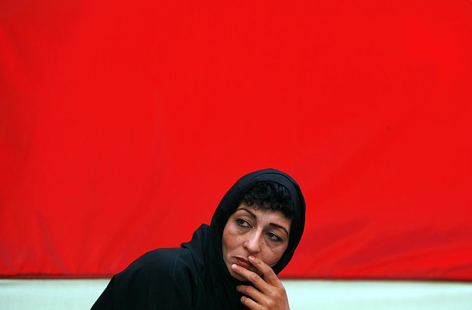 Афганская женщина во время церемонии по началу предвыборной гонки кандидата в президенты Ашрафа Гани в Кабуле. Предвыборные компании кандидатов в президенты Афганистана официально стартовали во вторник. (Ahmad Masood/Reuters)