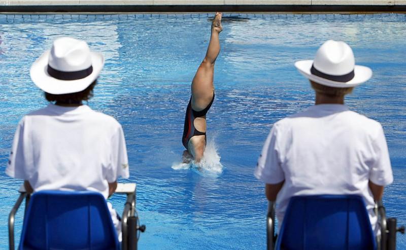 5) Канадская пловчиха Розелин Филион во время отборочных соревнований среди женщин по прыжкам в воду, которые прошли в ходе Чемпионата мира по водным видам спорта в Риме. (Max Росси/Reuters)