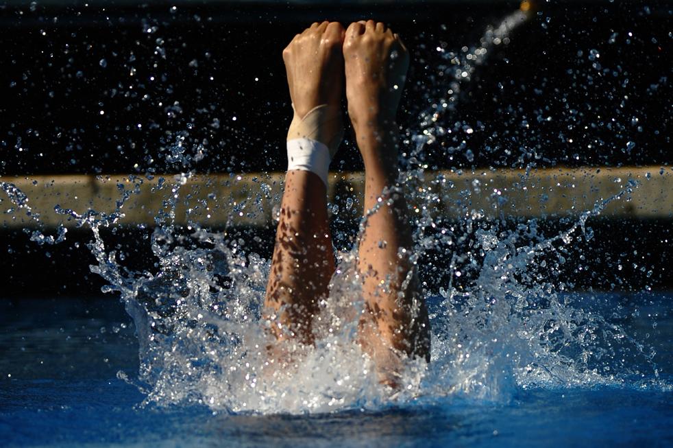 11) Китайская спортсменка Ван Хань во время финала среди женщин по прыжкам в воду с 1-метрового трамплина на Чемпионате мира по водным видам спорта в Риме 19 июля. (AFP/Getty Images/Filippo Monteforte)