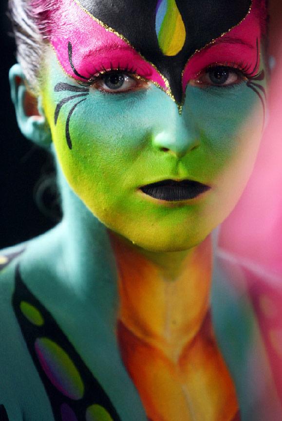 14. Модель Алана Кирби за сценой церемонии награждения победителей соревнования по боди-арту в центре Брюса Мэйсона в городе Оклэнд, Новая Зеландия, 25 июля. (Sandra Mu/Getty Images)