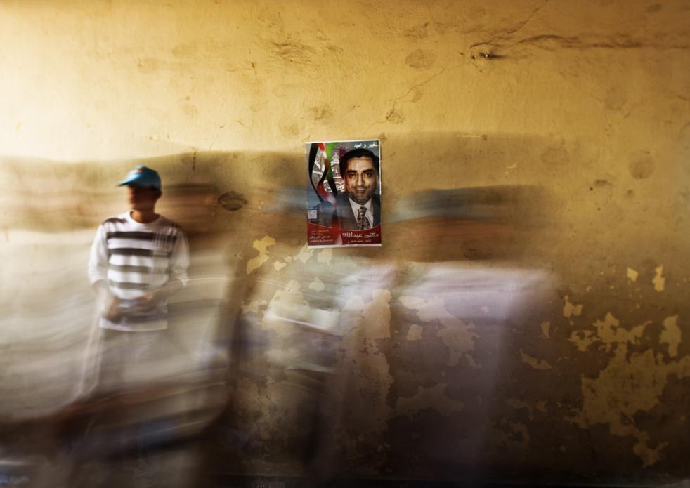 15) 15. Сторонники кандидата в президенты Афганистана Абдуллы Абдуллы (на фото в центре) спешат на избирательный митинг на Национальном стадионе Кабула в Афганистане в понедельник, 17 августа. (AP/Dima Gavrysh)