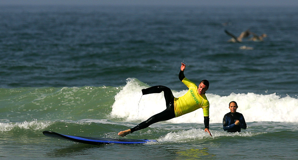 14) Параолимпиец Марк Барр падает со своей доски 14 августа. (Ezra Shaw/Getty Images)