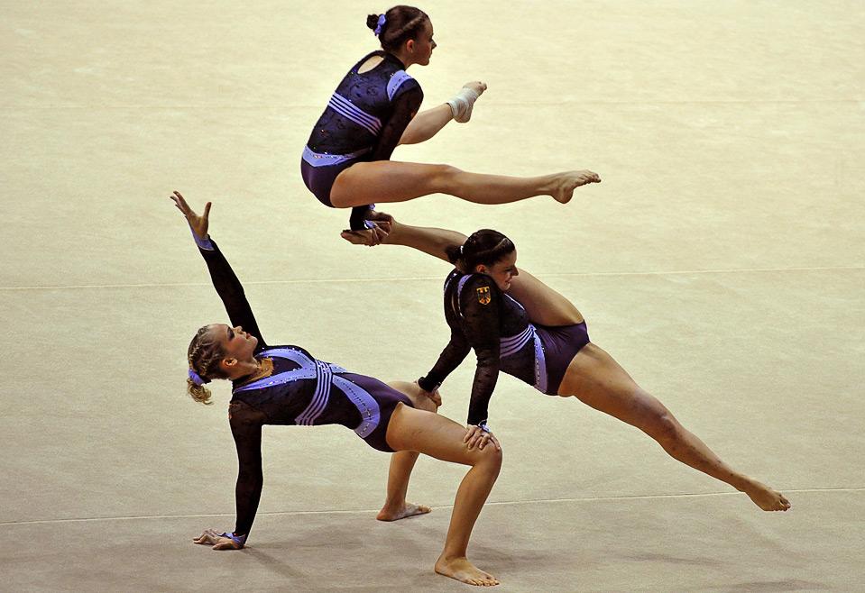 5) Немецкие гимнастки в групповом соревновании по акробатической гимнастике на Всемирных играх в г. Гаосюн 21 июля.  (SAM YEH/AFP/Getty Images)