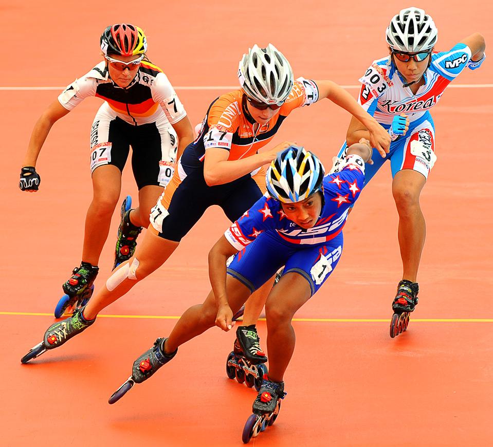 4) Американка Сара Саясэйн лидирует во время скоростных гонок на роликах на Всемирных играх в г. Гаосюн 18 июля.  (SAM YEH/AFP/Getty Images)