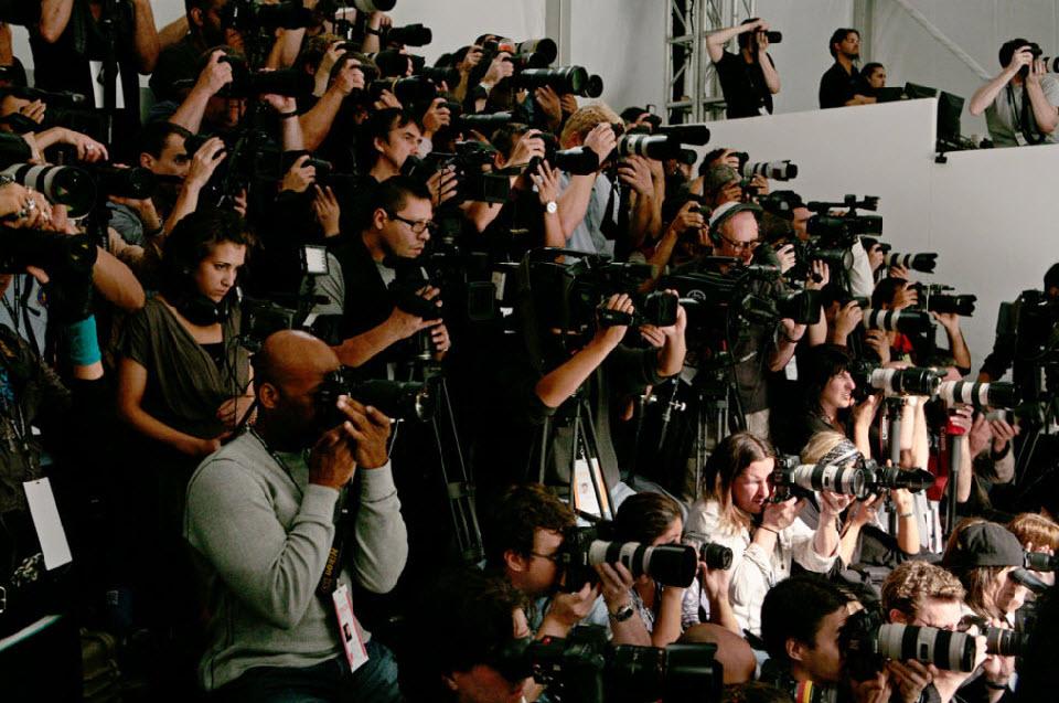 29) Фотографы за работой.