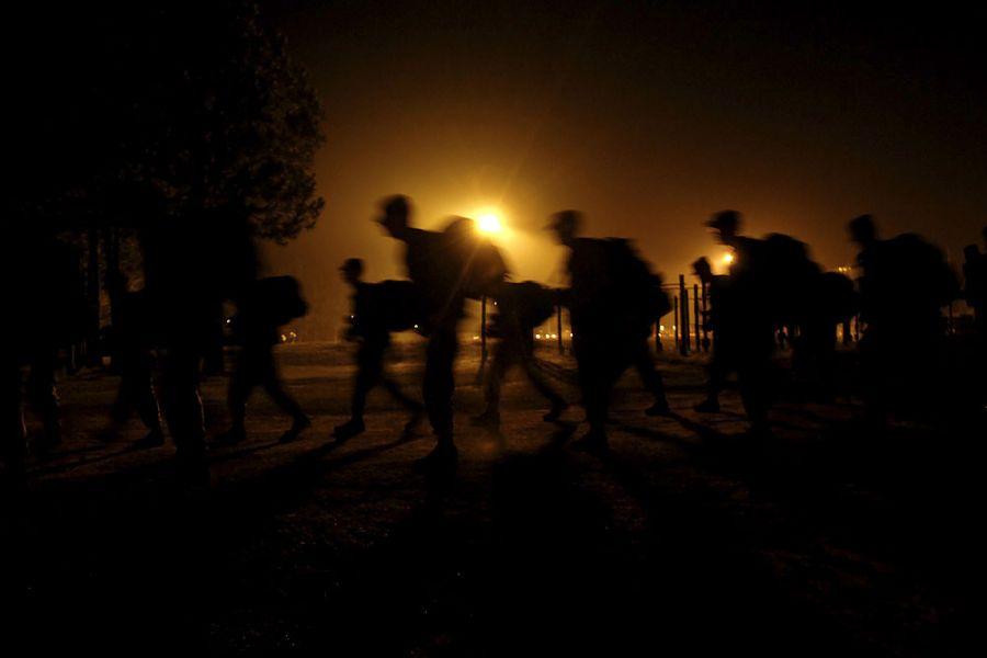 21. 15 августа 2007 года 6:05. День молодого бойца начинается с 8-километровой пробежки с рюкзаками до тренировочного полигона в Форт Бреннинге.