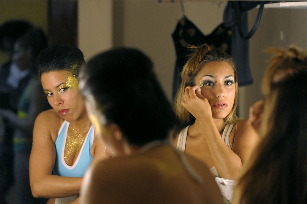 """10) Argentinian pole dancers prepare backstage for the start of the """"Miss Pole Dance Argentina 2009"""" and """"Miss Pole Dance South America 2009"""" competitions, in Buenos Aires, Argentina on October 20, 2009. Brazilian dancer Rafaela Montenero took first place in the """"Miss Pole Dance South America 2009"""" and Argentinian pole dancer Maria Luz Escalante took the """"Miss Pole Dance Argentina 2009"""" title. AFP PHOTO/JUAN MABROMATA (Photo credit should read JUAN MABROMATA/AFP/Getty Images)"""