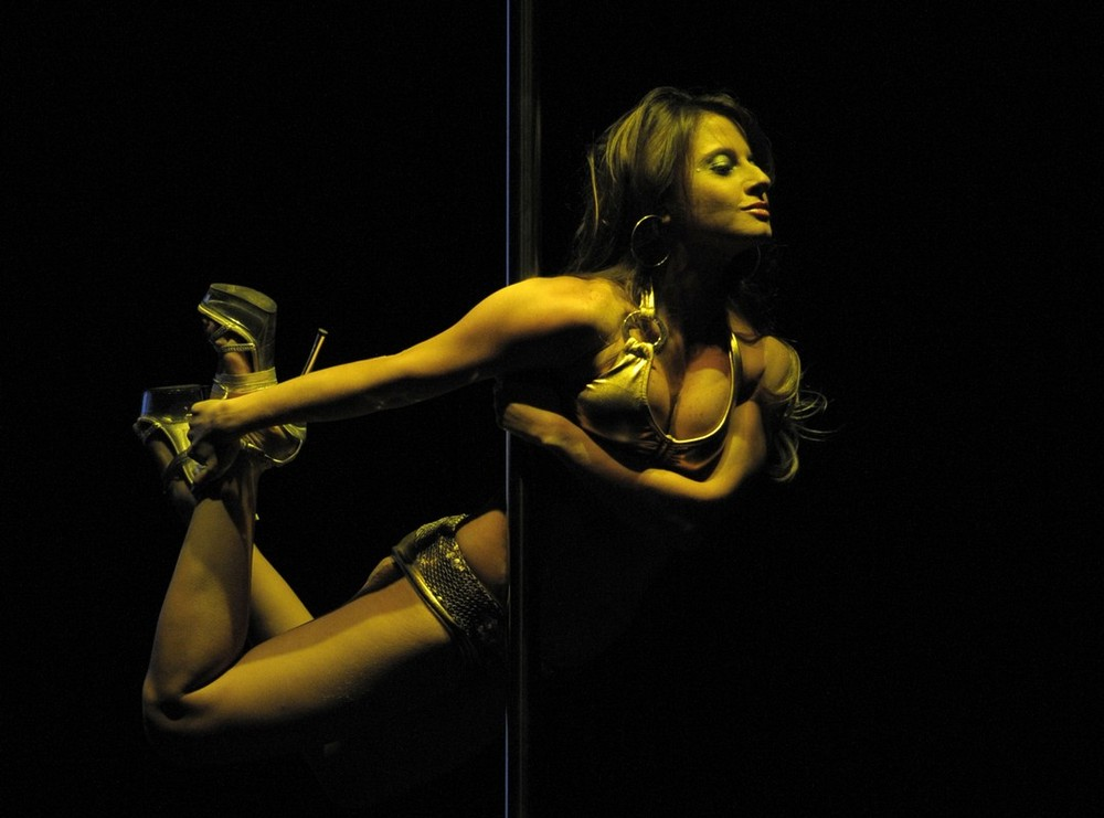 """11) Venezuelan pole dancer Romina Dabbio performs during the """"Miss Pole Dance South America 2009"""" competition in Buenos Aires, Argentina on October 20, 2009.  The competition was won by Brazil's Rafaela Montenero. AFP PHOTO/JUAN MABROMATA (Photo credit should read JUAN MABROMATA/AFP/Getty Images)"""