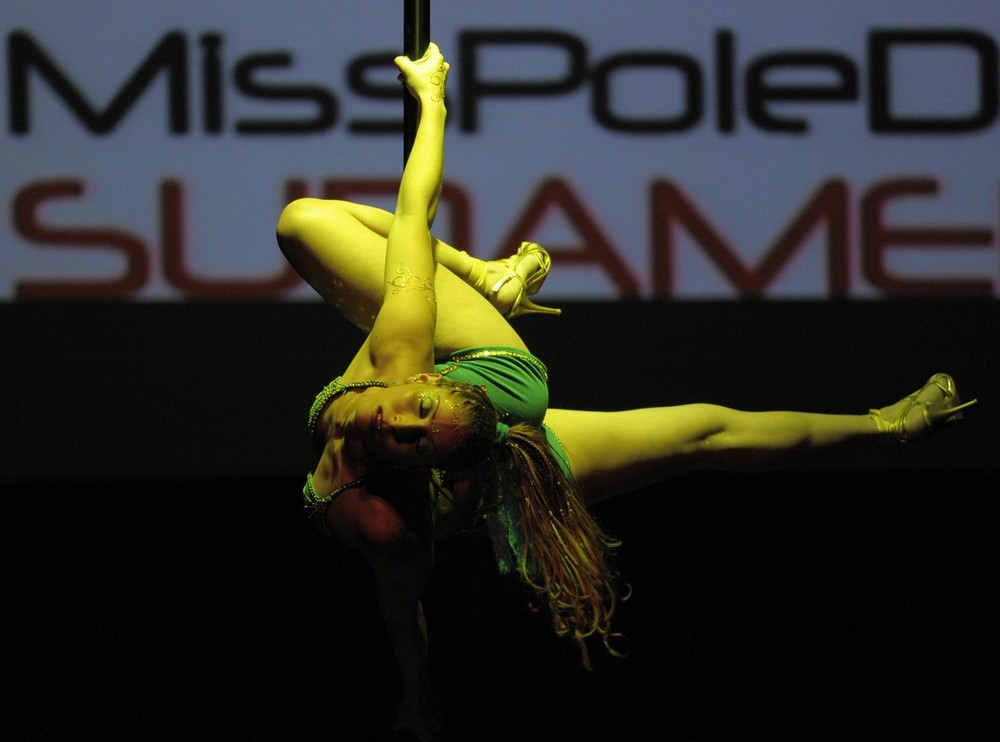"""8) Brazilian pole dancer Eduarda Ribeiro performs during the """"Miss Pole Dance South America 2009"""" competition in Buenos Aires, Argentina on October 20, 2009.  The competition was won by Brazil's Rafaela Montenero. AFP PHOTO/JUAN MABROMATA (Photo credit should read JUAN MABROMATA/AFP/Getty Images)"""