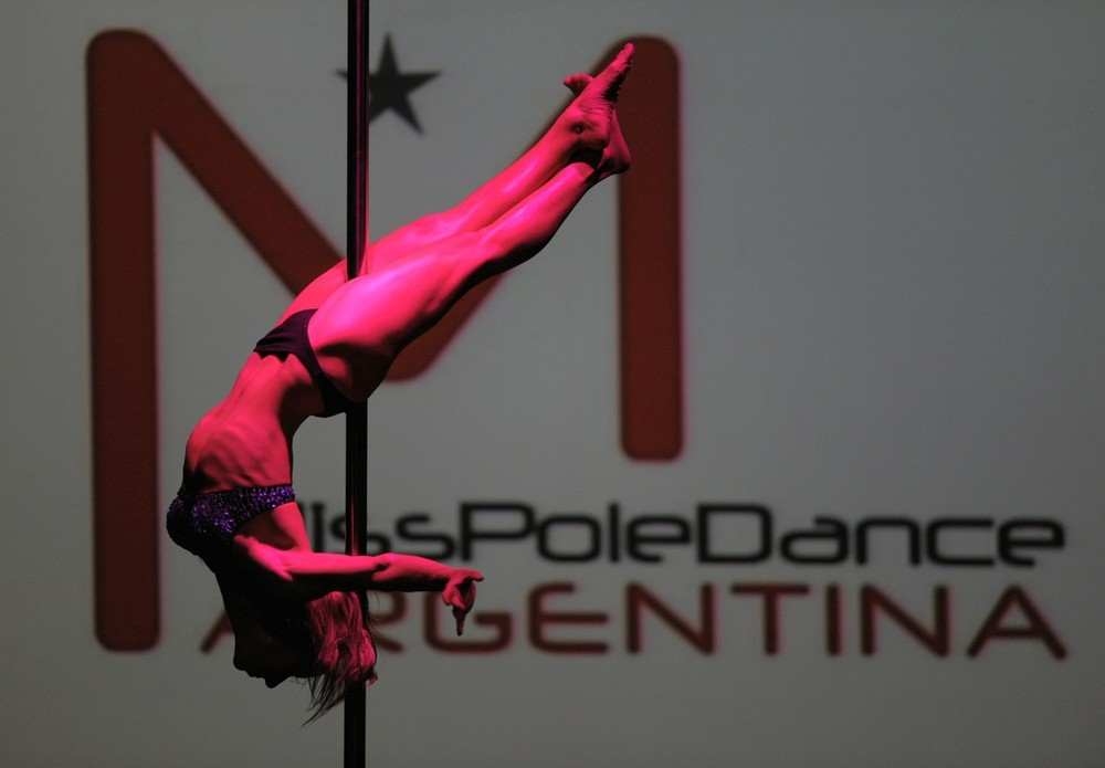 """9) Argentinian pole dancer Maria Luz Escalante gives her winning preformance in the """"Miss Pole Dance Argentina 2009"""" competition in Buenos Aires, Argentina on October 20, 2009. Escalante won second place in the """"Miss Pole Dance South America 2009"""" competition. AFP PHOTO/JUAN MABROMATA (Photo credit should read JUAN MABROMATA/AFP/Getty Images)"""