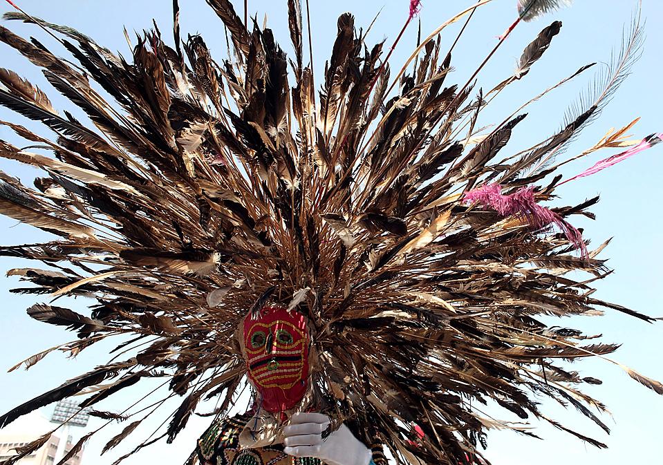 2) Участник Абуджийского культурного карнавала в городе Абуджа, Нигерия. (Goran Tomasevic/Reuters)
