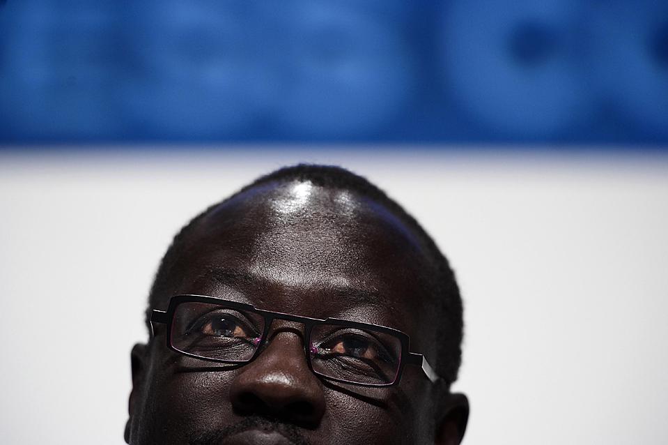 3) Руководитель блока развивающихся стран, Лумумба Станислаус Ди-Апинг из Судана, во время пресс-конференции ООН по изменению климата в Копенгагене. (Claus Bjoern Larsen/POLFOTO/Associated Press)