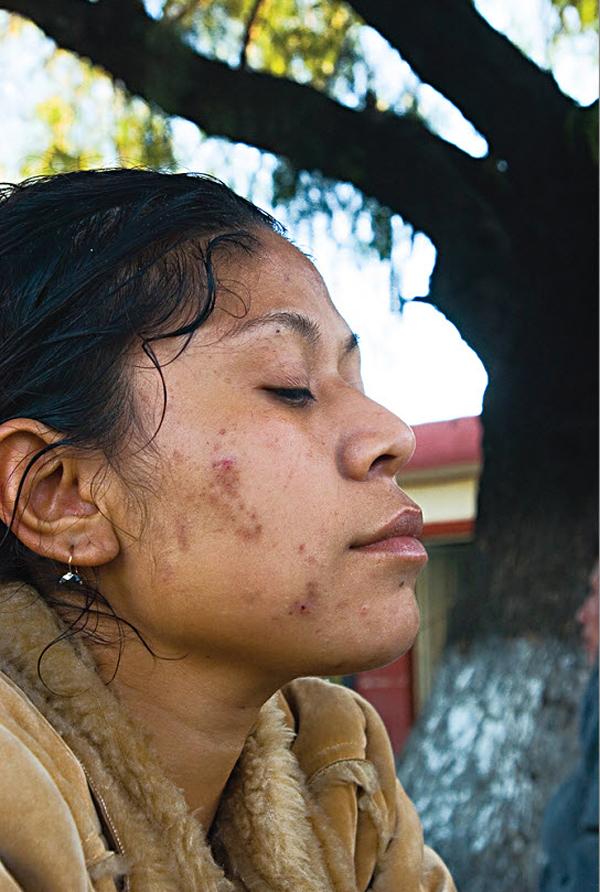 8. Женщина из Эль Сальвадор в пункте для иммигрантов Белен Посада дель Мигранте, Сатилло, Мексика, в октябре 2008 года. (Diana Castillo and Dariela Diaz)