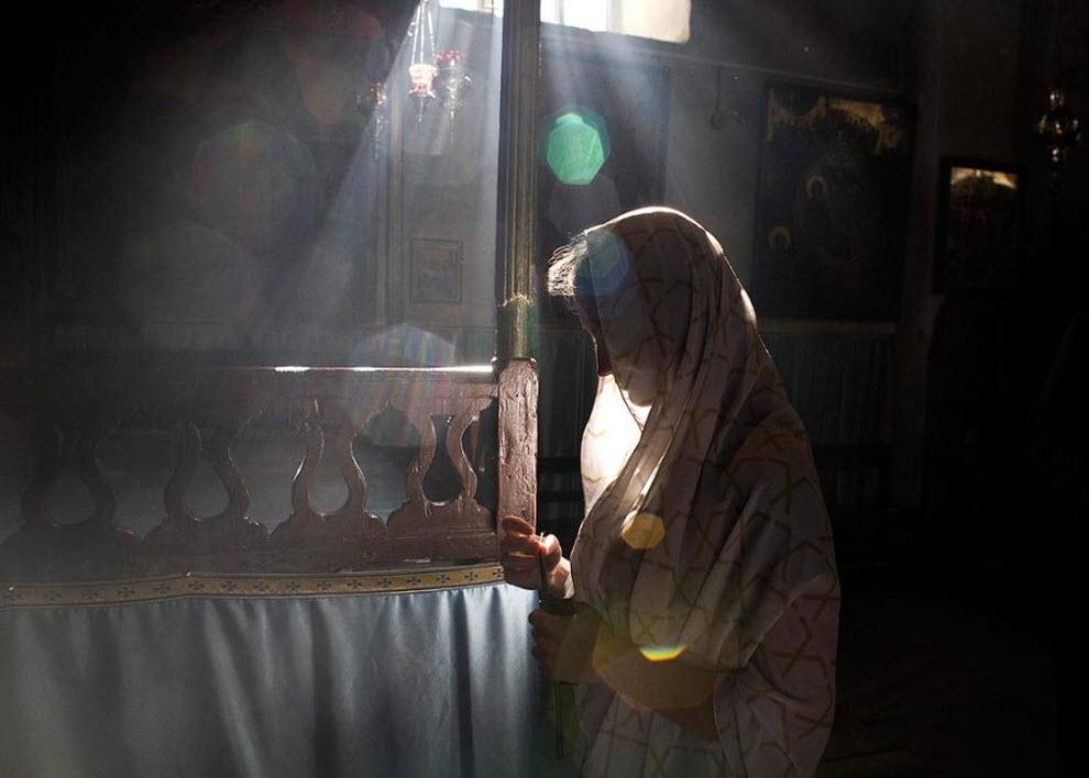 4. Паломница из России молится 21 декабря. (Tara Todras-Whitehill, AP)
