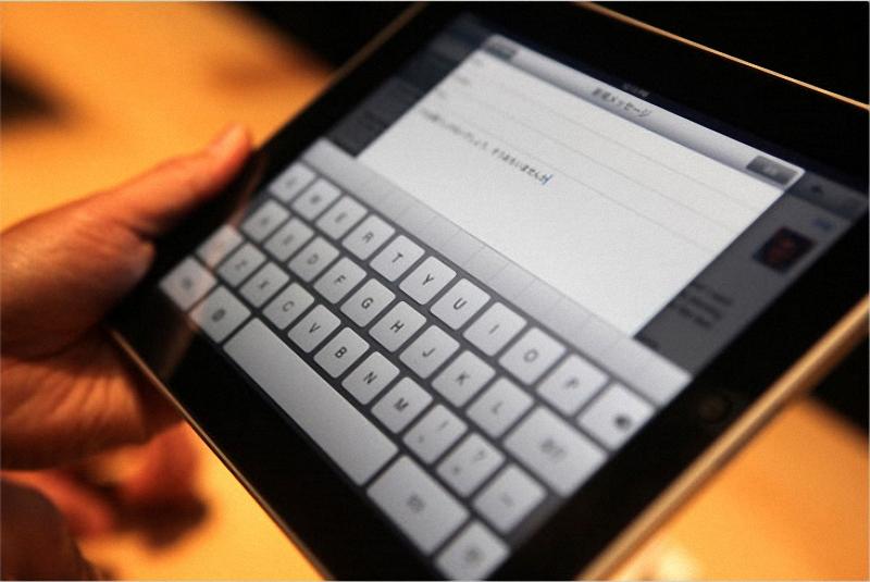 4. iPad имеет сенсорную клавиатуру и работает как в горизонтальном, так и в вертикальном режиме, как и iPhone. (Kimberly White/Reuters)