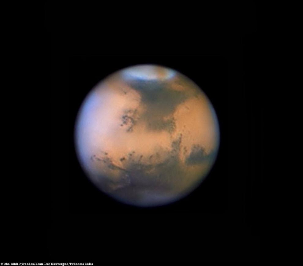 15) Пылевая буря на Марсе.