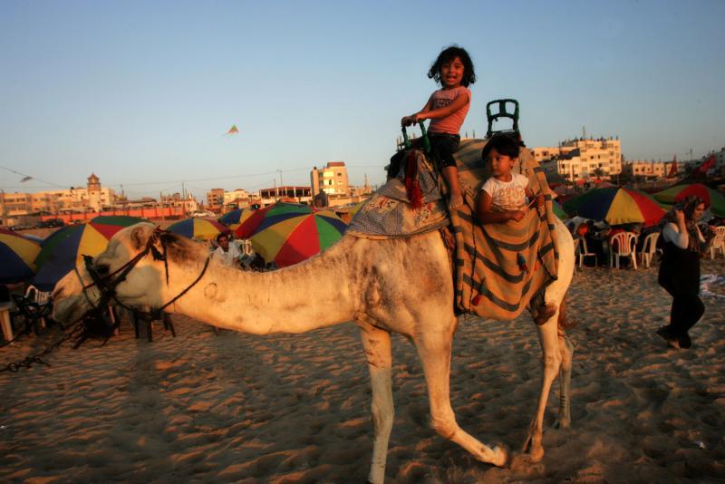 Palestinians enjoy a beach in Gaza