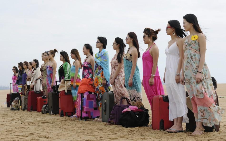 1. Это не кастинг на конкурс красоты. Это будущие телохранительницы в первый день тренировки в китайском городе Санья. (Reuters)