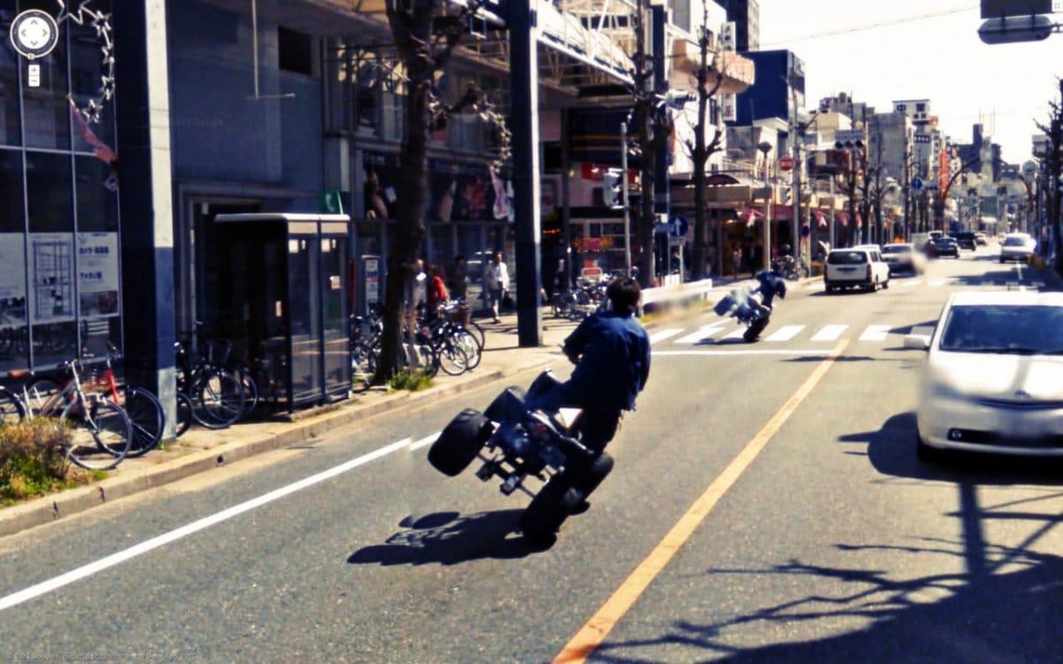 Bigpicture ru and a man popping a sideways wheelie