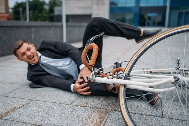 Bigpicture ru businessman fell off his bike at the office building in downtown business person riding on eco transport on city street 266732 10228
