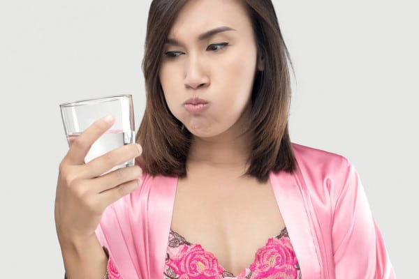 Bigpicture ru depositphotos 199337876 stock photo asian woman rinsing and gargling