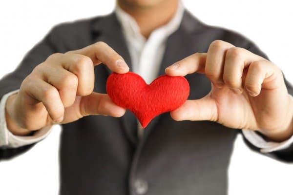 Bigpicture ru depositphotos 72567303 stock photo businessman gives a red heart