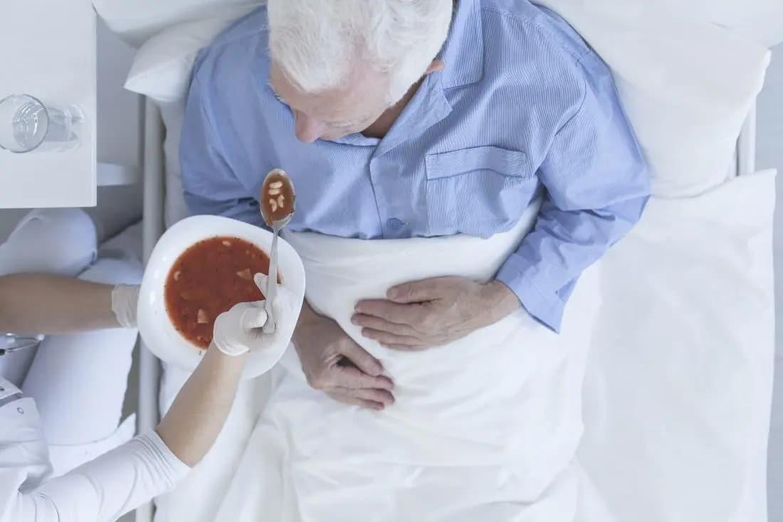 Bigpicture ru older man being fed in a hospita