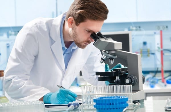 Bigpicture ru depositphotos 67430013 stock photo scientist looking through a microscope