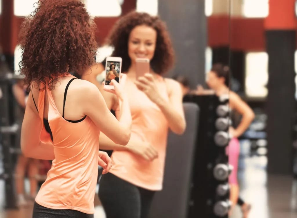 Bigpicture ru woman taking gym weight loss sel